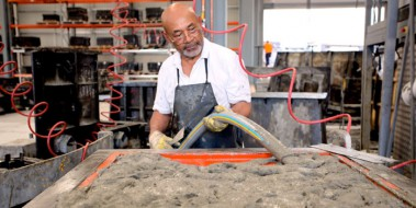 Man pouring GRC into a mould for GRC manufacturing